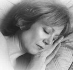 A sleeping woman endures sweating